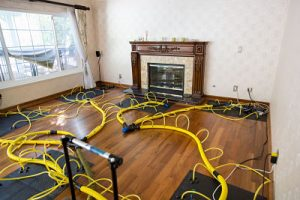 water damage restoration equipment in a living room